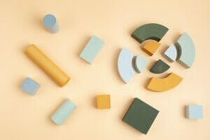 Abstact flat lay with geometric forms over beige background